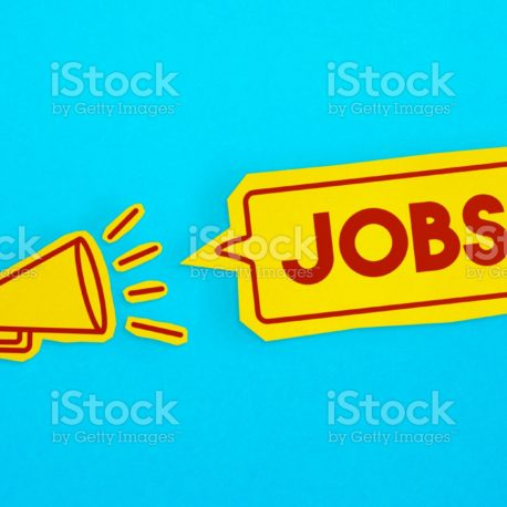 """Megaphone drawing on the cut yellow paper makes """"Jobs"""" announcement. Horizontal composition with copy space. Communication Concept."""